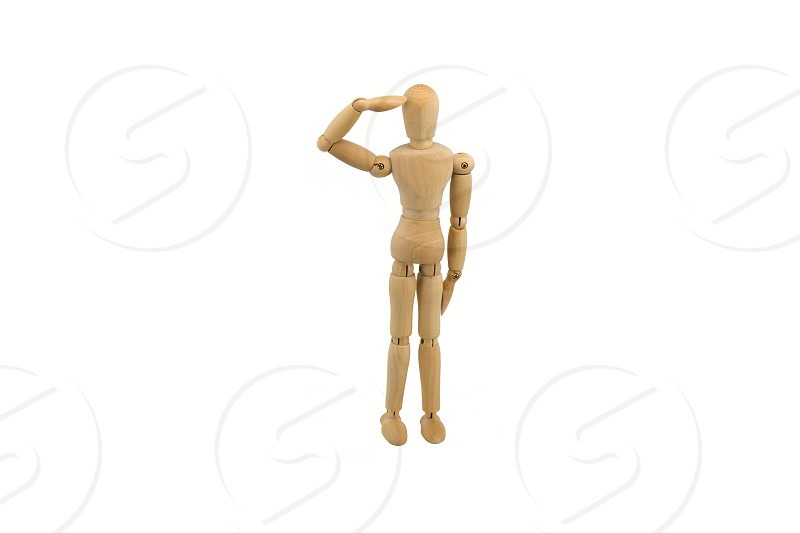 Wooden drawing figure bringing salute photo