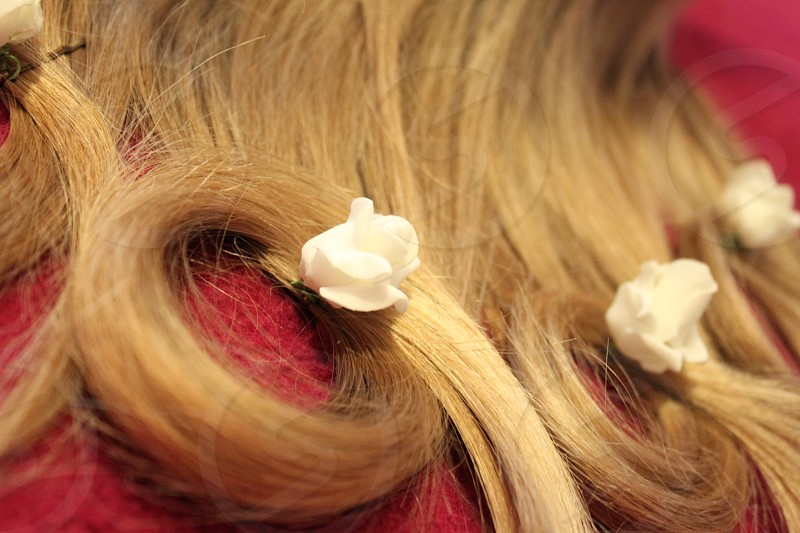 brown human hair with white flower embellished photo
