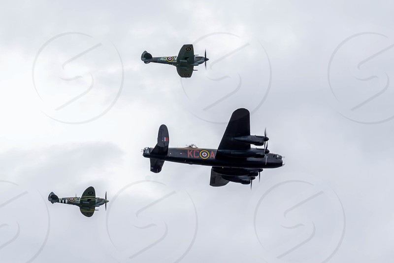 Avro Lancaster flanked by two Spitfires photo