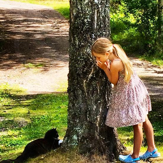 Cat girl child Sweden playing fun pet photo