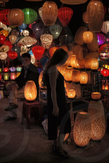 Tourism woman looking at lantern at the night market in Hoi An Vietnam photo