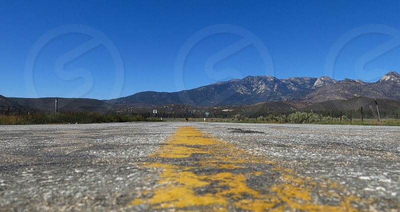 Road and mountains near the Palms to Pines scenic byway in Southern California. photo