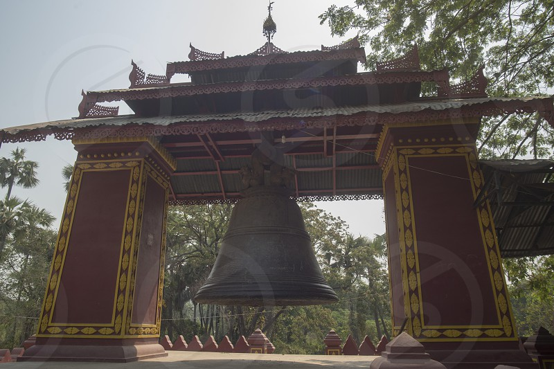 a bell in a temple in Amarapura near the City of Mandalay in Myanmar in Southeastasia. photo