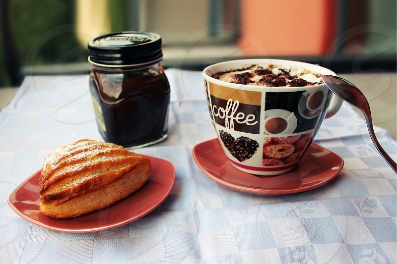 Italian breakfast capuccino and chocolate sfogliatella  photo