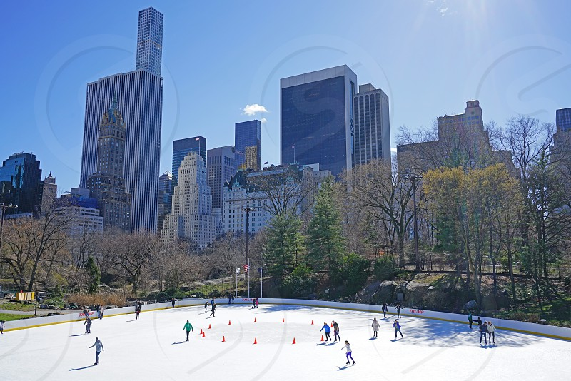 People skating on the ice rink in Central Park in midtown Manhattan New York City photo