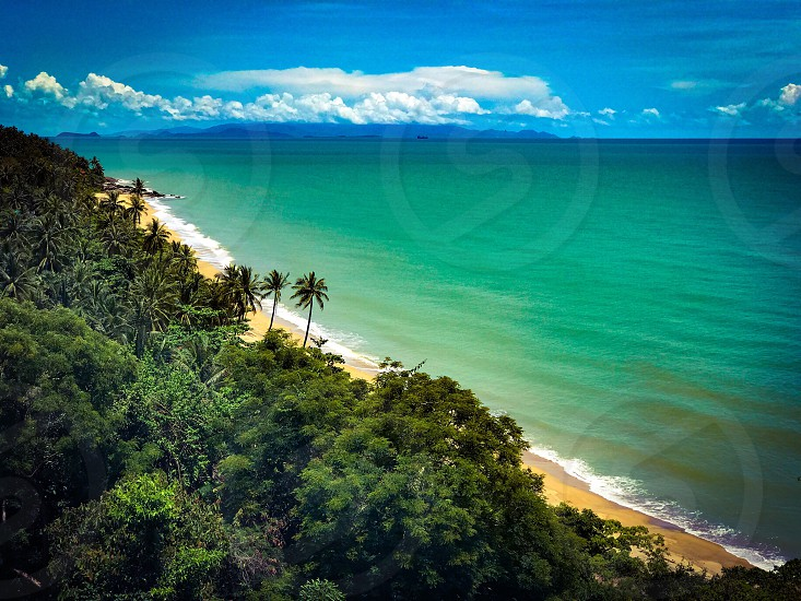 beach sea ocean travel sky nature island landscape sand horizon coast tropical vacation cloud reflection wave silhouette orange summer morning golden blue evening colorful color background water serenity holiday bay outdoor coastline calm holiday background destination sky background thailand seascape romantic palm coconut sandy tide shore rock seaside photo