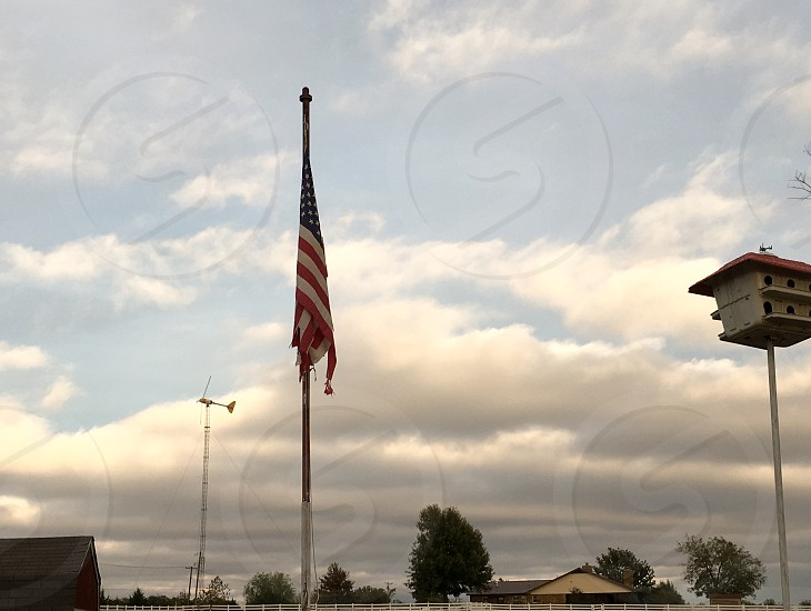 Clouds Sky Country American Flag Flag Flagpole America Birdhouse Windmill Trees Field photo