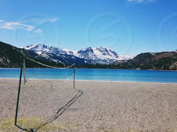 gray net on seashore near blue sea photo