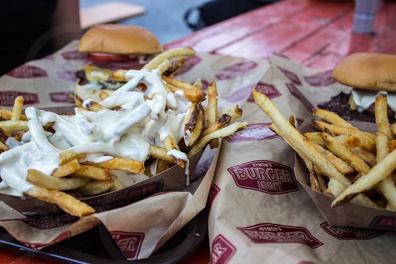 french fries with mayonnaise on top photo
