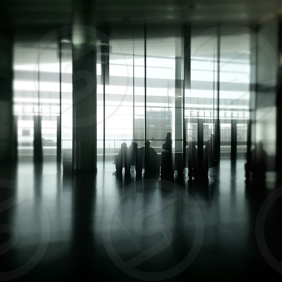 people beside exit glass door photo