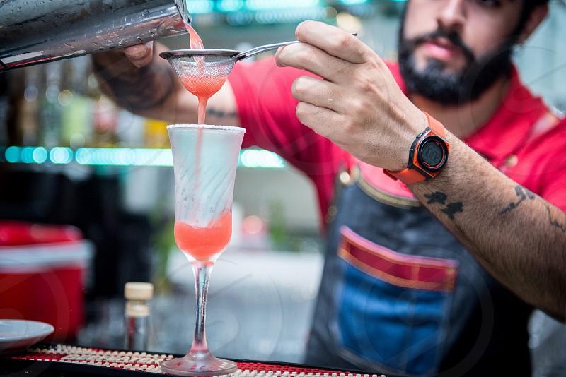 Barman making delicious drinks!  photo