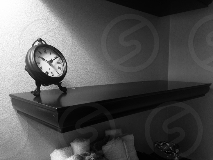 black and white clock shelf home photo