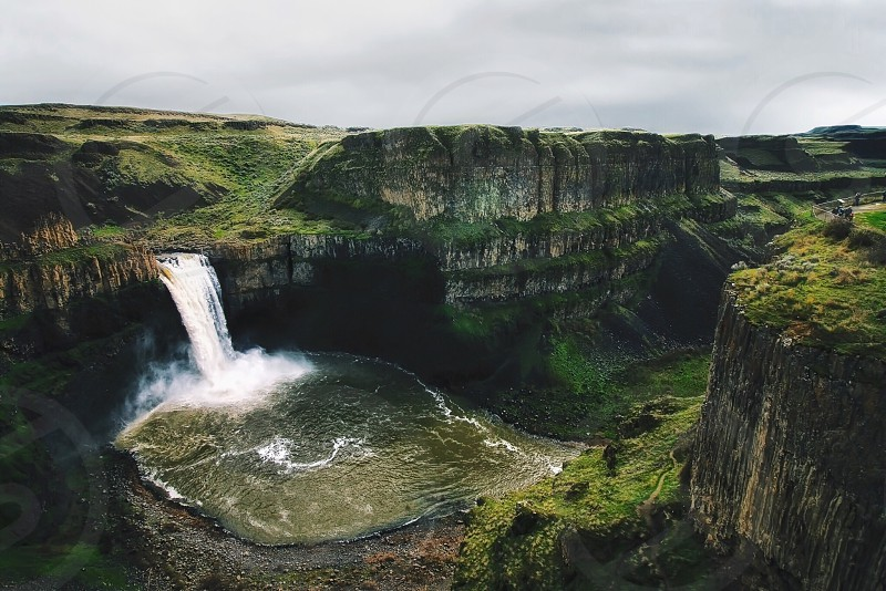 landscape photography waterfall over green covered cliffs photo