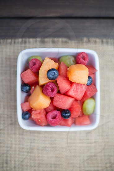 fresh organic sliced watermelon blueberries raspberries grapes - diced and ready to be served. photo