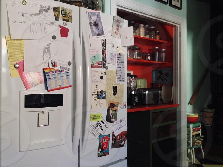 Refrigerator kitchen clutter magnets life list reminders fridge white appliance photo