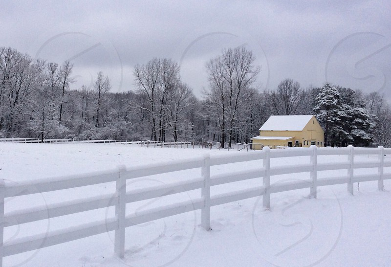 white wooden fence and white snow photo