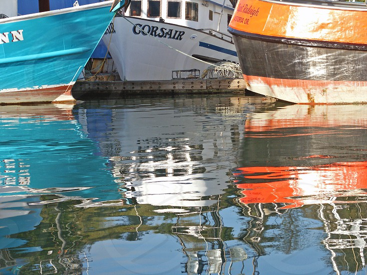 Reflections of colorful boats photo
