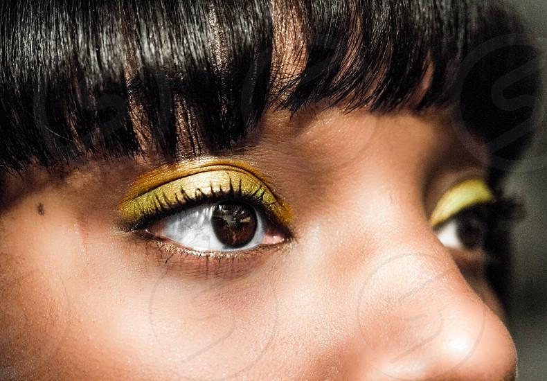 woman wearing yellow eyeshadow photo