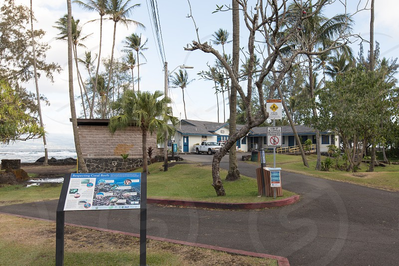 The entrance and park buildings of the black sand beach at Richardson Beach on the Big Island of Hawaii in Hilo. photo
