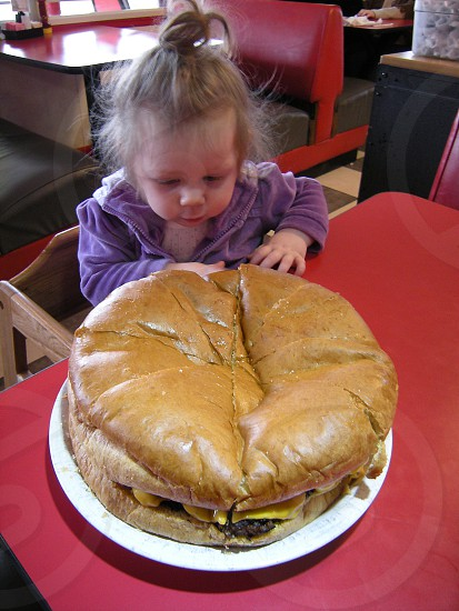 Toddler with giant burger photo