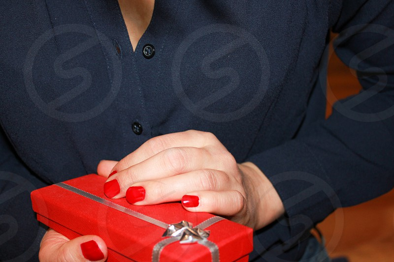 woman in a blue dress with a gift in her hands photo