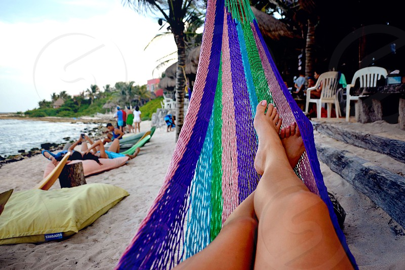 Relaxing in a hammock on the beach photo