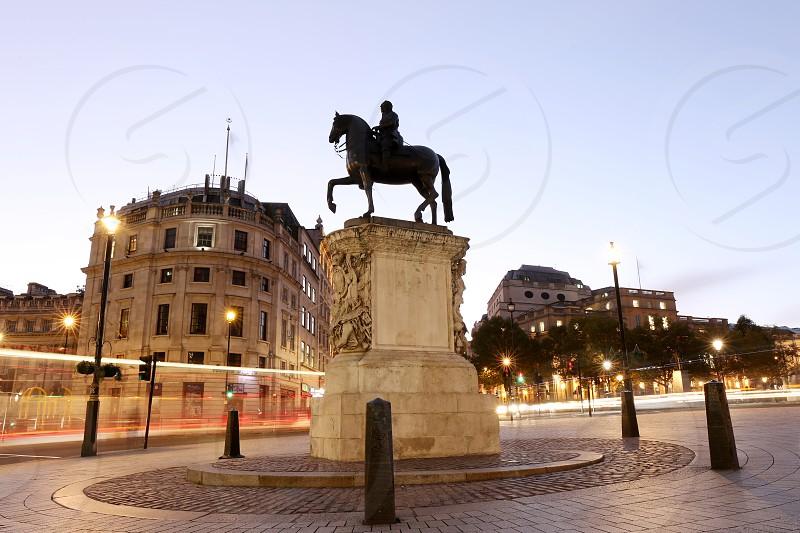 Charring Cross Square; Trafalgar Square; london; uk; england; travel; night; shot; light trails; traffic; cars; Equestrian statue of King Charles I;  photo