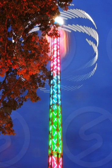carnival ride with lights turned on photo
