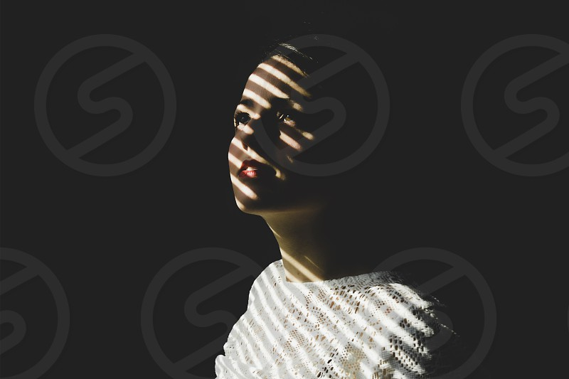 shadow blinds light blinds darkness smile waiting woman  photo