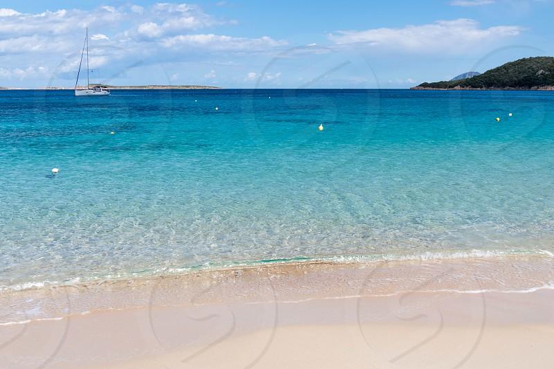 Yacht off Liscia Ruja beach Sardinia photo
