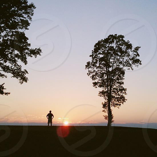 man and sunset silhouette photography photo