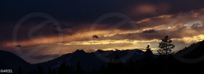 view of mountain during sunset photo