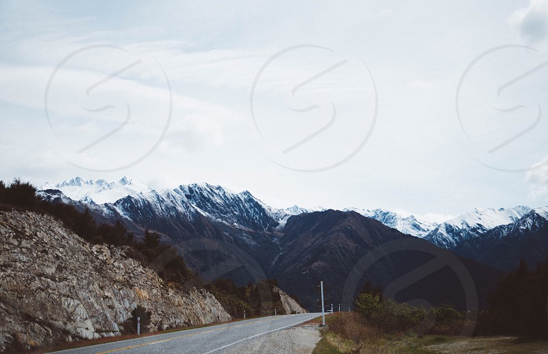 New Zealand nature landscape beauty beautiful south South Island road mountains snow winter cold climb hike car journey sign rocks nature natural cloudy  photo
