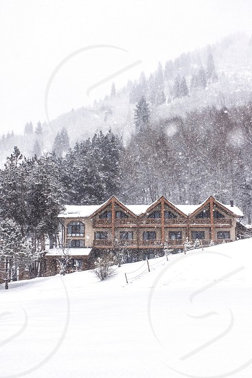 mountains hotel architecture forest snow chalet. photo