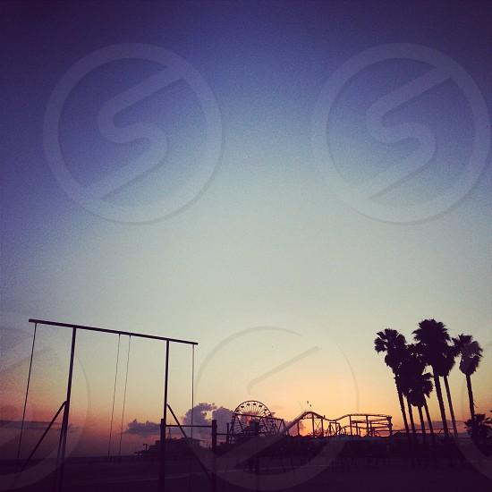 Santa Monica Beach. Sunset. Pier. Rollercoaster. Rings. photo