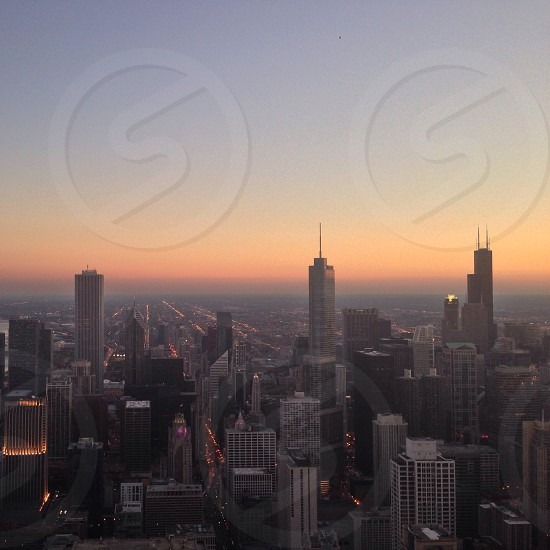 view of city buildings on a sunset photo