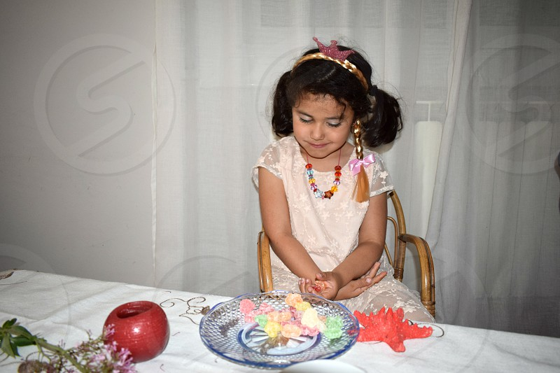 child girl dressed fancy dinner table clothes elegant dress crown happy childhood funny  photo