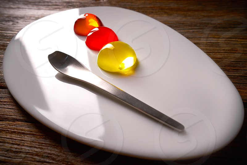 Molecular cuisine concept spheritions colorful in moodern oval plate jelly texture photo
