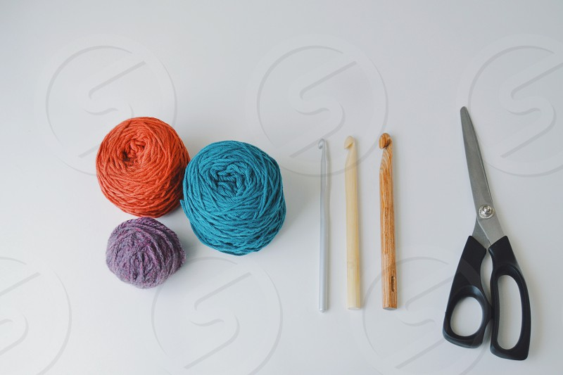 Flat lay of some crocheting supplies photo