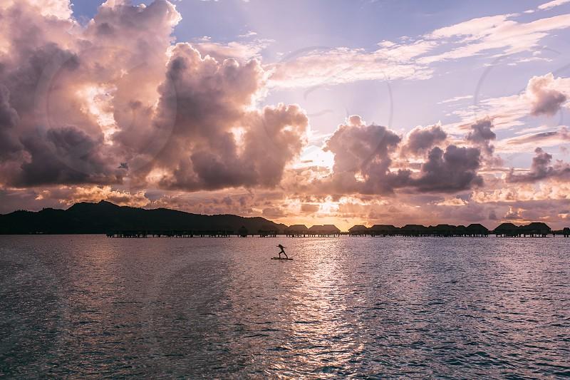 Bora Bora sunset paddle board yoga photo