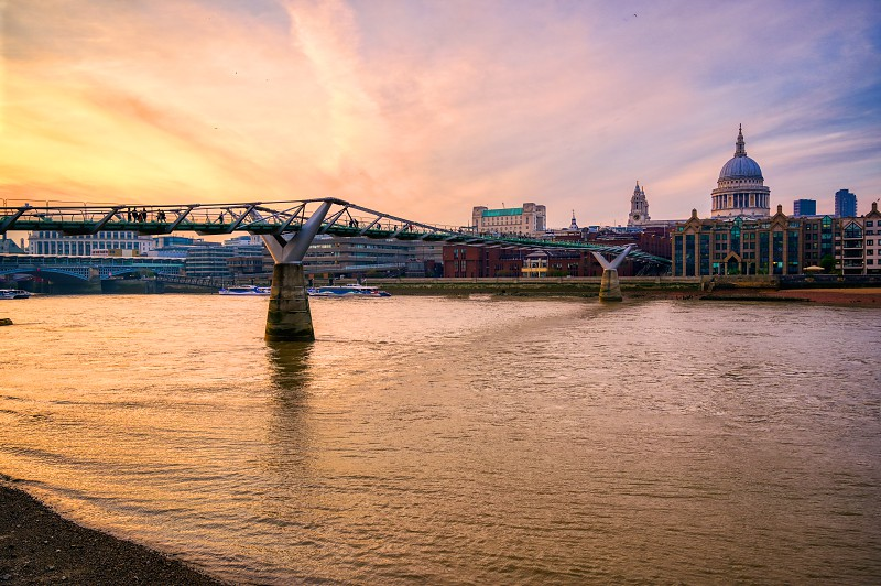 St. Paul's Cathedral across Millennium Bridge and the River Thames in London UK. photo