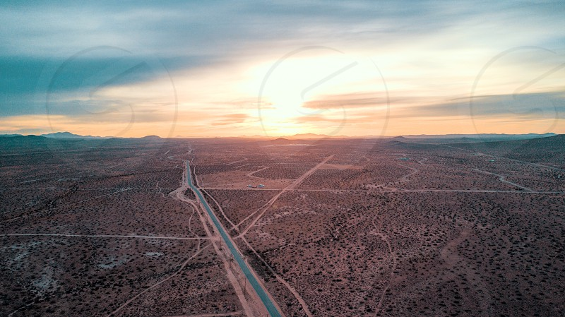Aerial drone desert mountain sunset road mojave  valley  dirt California  photo