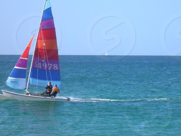 Colourful sailboat across the sea photo