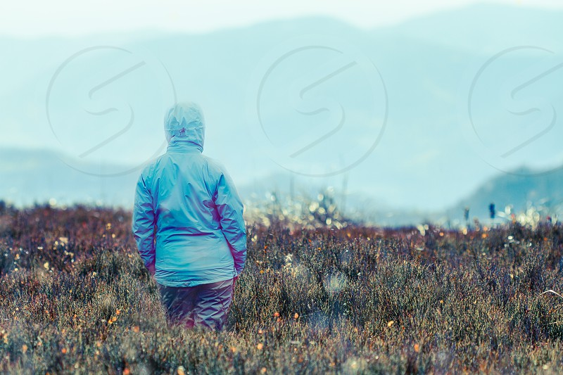 Girl looking at the mountains photo
