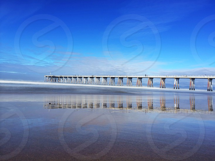 a long bridge by the shore photo