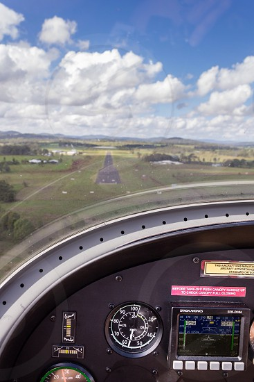 Flying aviation gauge cockpit small plane runway approach landing photo
