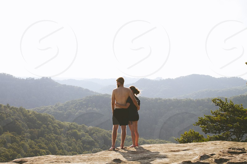A couple looking out at red river gorge ontop of court house rock photo