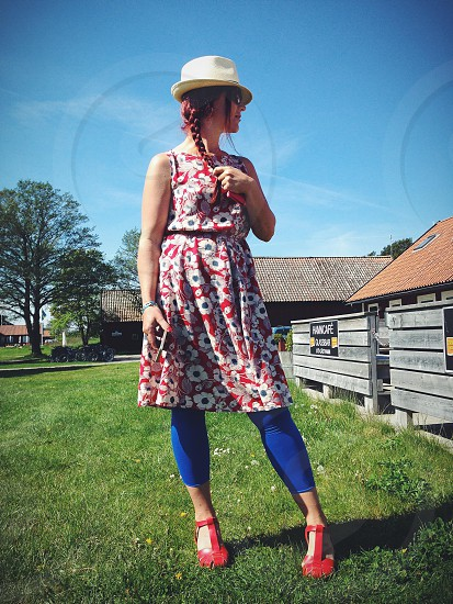 woman in red and white floral printed dress fashion photography photo