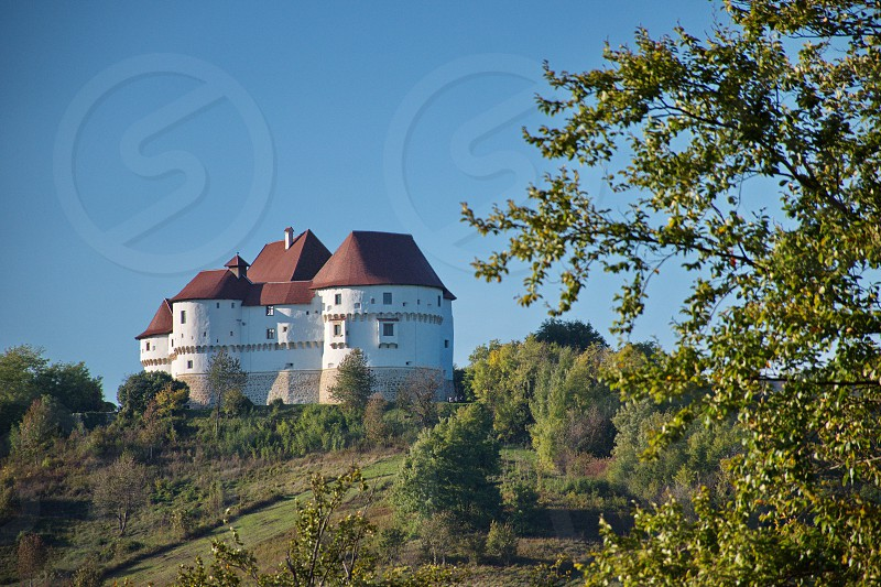 Scenic view of Veliki Tabor castle on the top of the hill against the blue sky photo