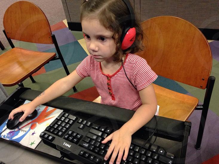 girl on computer table photo